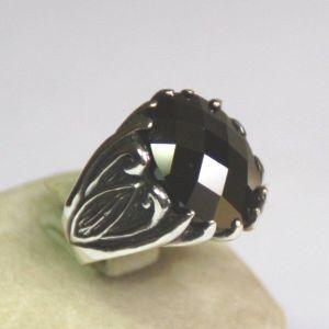 Αντρικό ασημένιο δαχτυλίδι με όνυχα .